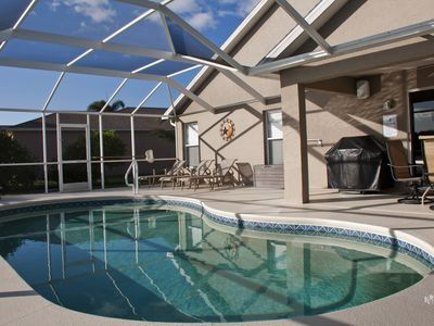 Photo for 'SPARKLING WATERS'  South Facing  Pool House  with Lake View in Beachwalk Isles
