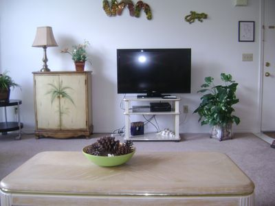 living room with cable tv, wi-fi, and telephone.