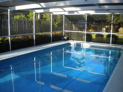 Photo for Lovely 3 bed 2bath home, beautiful patio, heated saltwater pool!