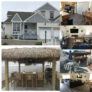 Photo for 4 bedrooms, 5 min walk to private beach with its own backyard tiki bar