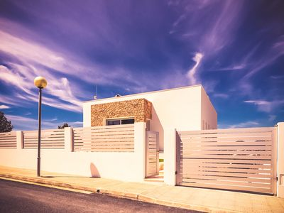Photo for Wonderful bright design villa with pool very close to Ibiza town for 8 guests
