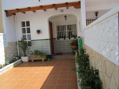 Photo for SEMI-DETACHED HOUSE WITH PATIOS, BBQ, FREE WIFI AND PARKING 5 'A FOOT FROM THE BEACH