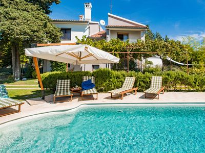 Photo for Spacious & peaceful holiday home with a large landscaped garden and private pool