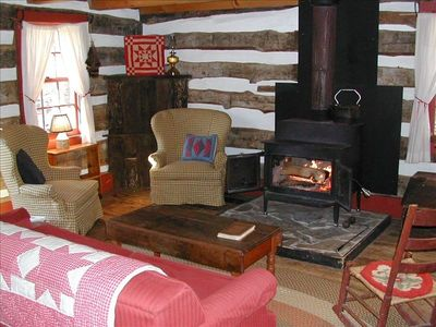 Living Room with the woodstove glowing, perfect for smores.