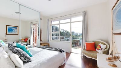 Bedroom with balcony looking out to Manly Beach.