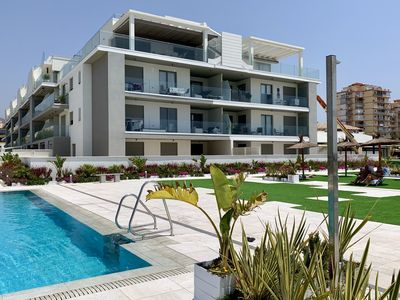 Photo for Penthouse closest to the sea with large private roof terrace, sea view, wi-fi and garage