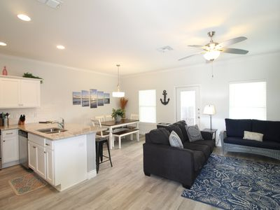 Photo for Beautifully furnished, 4 bedroom (2 masters), and walking distance to the beach!