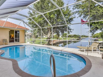 Photo for NEW LISTING! Beautiful home on the canal w/pool & dock -convenient location