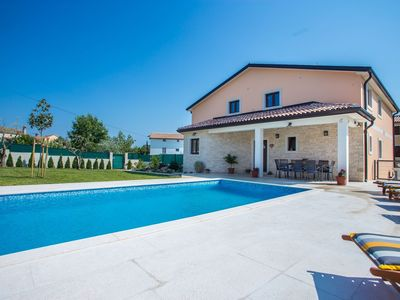 Photo for Tasteful villa with private swimming pool 8 km from Novigrad and the coast, near a water park