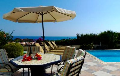 Dine al fresco and soak in the panorama of the bay from the comfort of the pool and patio