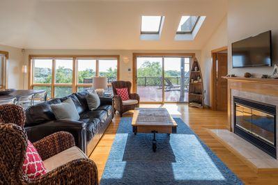 A spacious, airy living area featuring skylights leads out to our amazing deck..