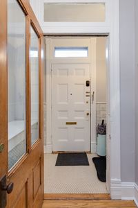 Original details throughout: hand-carved doors & railings, transoms, millwork...
