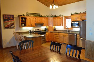 Gorgeous newly remodeled kitchen with open concept dining & vaulted ceiling