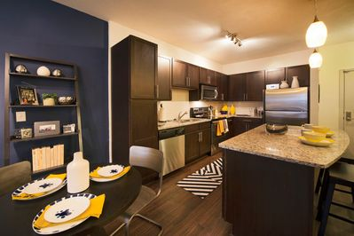 Kitchen Features Granite Counter Tops and Stainless Appliances