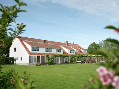 Photo for Semi-detached holiday home with facilities near the sea
