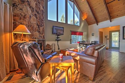 Hardwood floors and a stone fireplace provide guests with a warm environment.