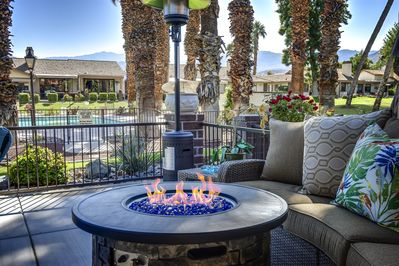 Romantic, fire pit for cozy nights, new patio couch. Great view of pool.