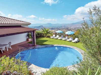 Photo for Traditional whitewashed villa w/ lawns, BBQ + pool, close to village