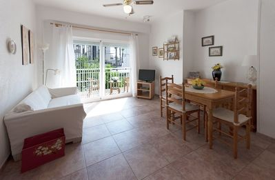 Photo for TALLAROL - Sunny apartment with furnished balcony on the second line to the beach.
