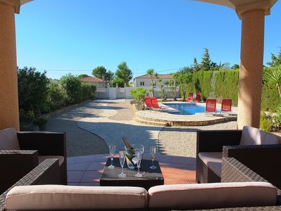 Photo for Pretty villa with a private swimming pool set in lovely gardens, air-con & WIFI