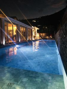 Heated swimming pool by night