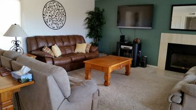 Living Room--leather couch and couch opposite are hide-a-beds.