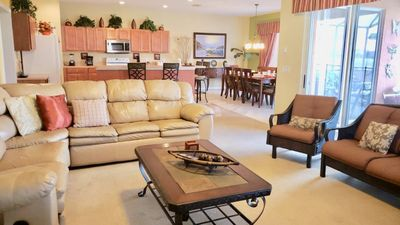 Photo for 6 bedroom with 5.5 bathroom vacation home for your large group that is minutes from Disney!