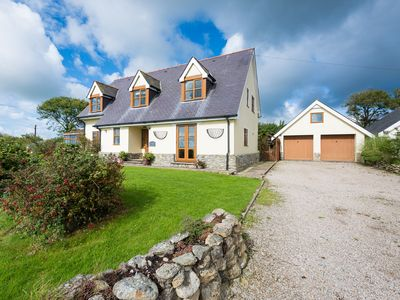 Photo for A peaceful rural location, extensive gardens, panoramic coastal views and beautifully presented spac