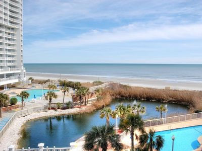 Enjoy indoor/outdoor pools, hot tub and all amenities at this resort near House of Blues