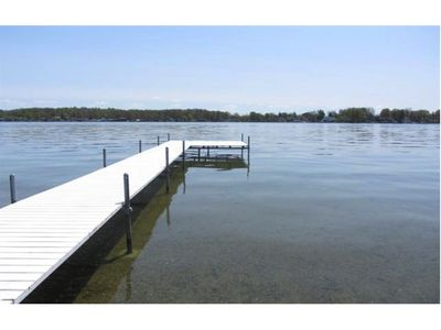 deck with shallow sandy beach and large section for fishing and boat docking