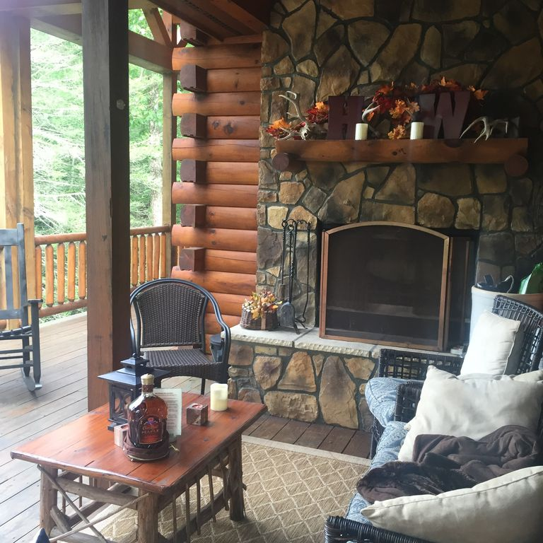 High whisper luxury log cabin outside fireplace hot tub for Log home fireplace pictures