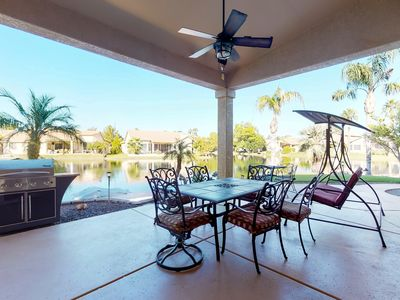 Photo for NEW LISTING! Lakefront home w/pedal boat, 270-degree views- near 9 golf courses