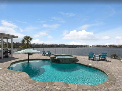 Photo for FANTASTIC Lake Front Home, Outdoor Area is LARGE with a Private Pool w/Tiki Bar