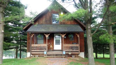 Front View of Cabin among a grove of pine trees