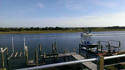 Standing on second story balcony watching boats go by...that is your dock too.