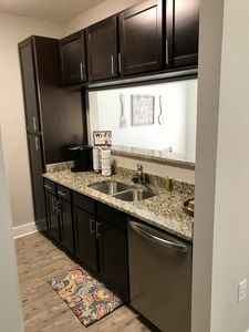 Kitchen with pass through to dining area