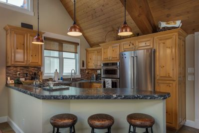 Updated kitchen with stainless steel appliances and granite countertops