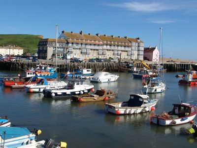 Photo for Cosy character apartment overlooking historic harbour and beach