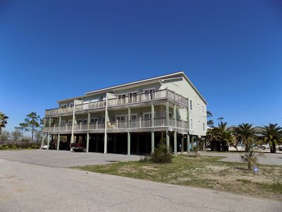 Photo for Waterfront condo on Bayou Heron, wet slip. swimming pool, beach access.