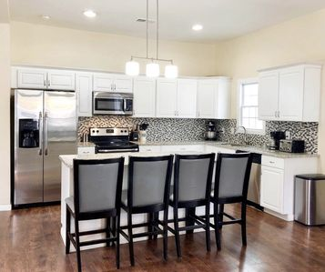 Photo for Southern Charm Minutes from Downtown - Sleeps 9