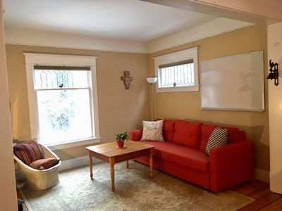Inviting living room with comfy pullout queen sized sleeper sofa.