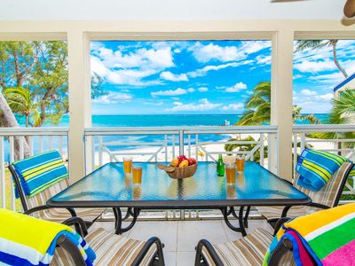Photo for Gorgeous beachfront condo steps from Rum Point and snorkeling! The Retreat #30