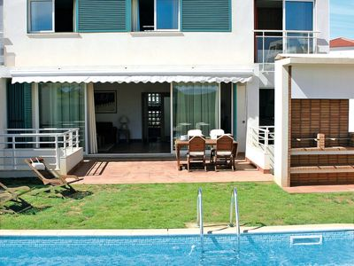 Photo for This 4-bedroom villa for up to 9 guests is located in Alvor and has a private swimming pool, air-con