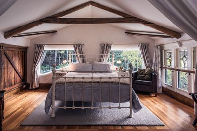 Sleep peacefully in a luxurious bed with enticing morning views out every window