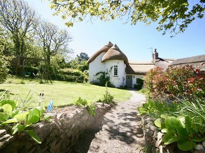 Photo for Putsborough Manor Cottage (4 + sofa bed + Cot) Dogs Tennis Beach Jacuzzi SKY TV