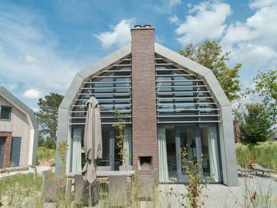 Photo for Stunning, new villa with sauna, surrounded by dunes and near the sea