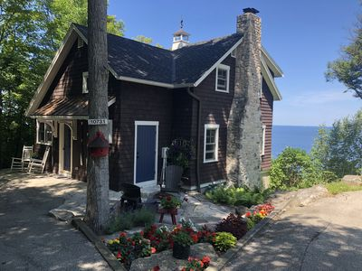 Photo for Charming home w/ AMAZING water views, walking path to town, hot tub, fireplace