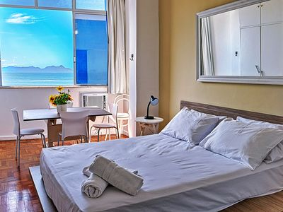 Photo for Cozy bedroom and living room with beautiful views of Copacabana beach for up to 6