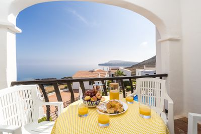 Breakfast with views over swimming pool to Fornells