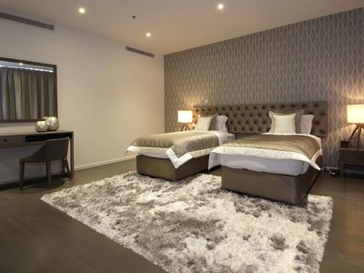 Photo for SIGNATURE HOLIDAY HOMES- LUXURY 5 BEDROOM APARTMENT, D1 RESIDENCES